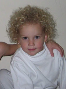 toddler with a wild mane of curly hair
